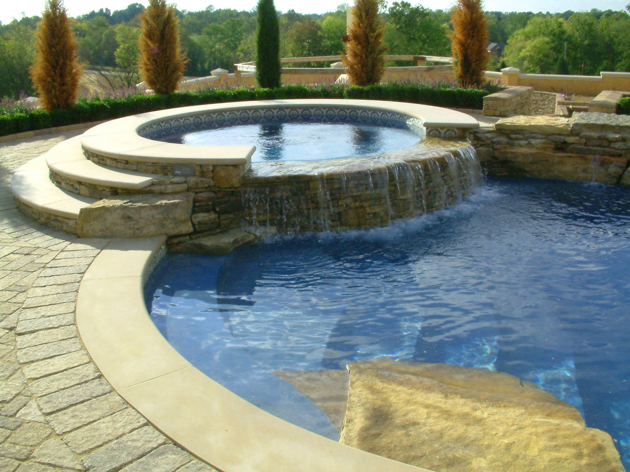 Unique features to add to your pool absolute pools - How much water in a swimming pool ...